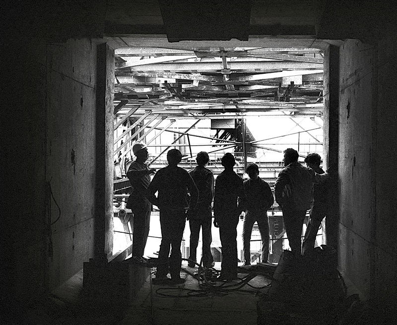 Workers silhouetted